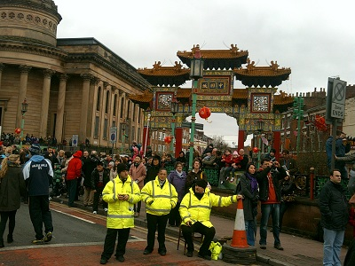 Chinese Arch and crowd during Chinese New Year celebrations 2011, Liverpool, England