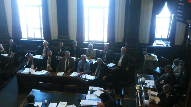 Council Chamber during meeting showing councillors, officers and Mayor's Chaplain
