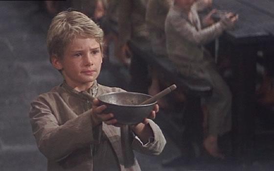Oliver asks for more porridge