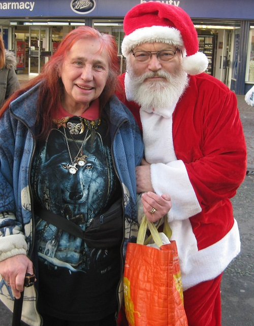 Leonora Brace (my wife) and Councillor Adrian Jones (as Father Christmas) in Birkenhead, Christmas 2013