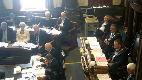 Mayor of Wirral Councillor Steve Foulkes and councillors listen to Councillor Phil Davies announce his Cabinet reshuffle 9th June 2014