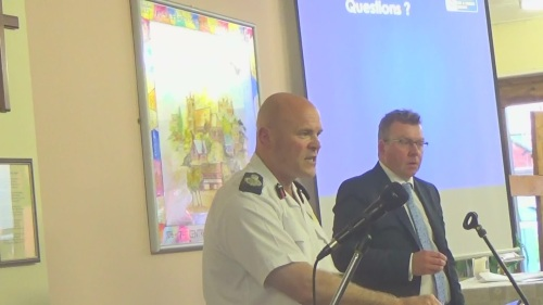 Dan Stephens (Chief Fire Officer, Merseyside Fire and Rescue Service) answers questions at a public consultation meeting in Saughall Massie to discuss proposals for a new fire station (20th April 2015). Kieran Timmins (Deputy Chief Executive) is on the right.