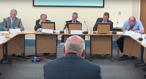 Cllr Chris Blakeley (foreground centre) the proposer of the Notice of Motion on flooding in Moreton at a public meeting last month